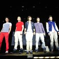 One Direction perform on their tour