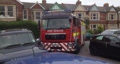 houses, fire engine, cars, stuck