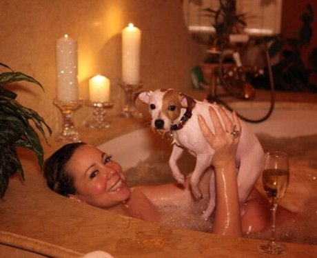 Mariah Carey with her dog in the bath