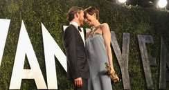 Anne Hathaway and Adam Shulman hug at the Oscars 2