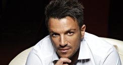 Peter Andre posing on a chair