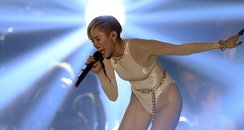 Miley Cyrus sings onstage