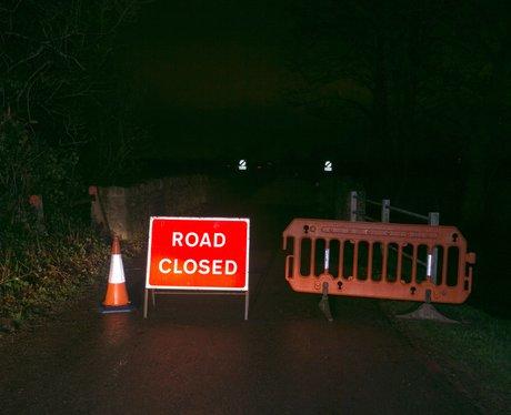 A sign blocking off a road