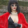 Rihanna in a red coat and garters