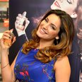 Kelly Brook squirting perfume on herself