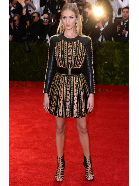Rosie Huntington Whitely in a black and gold dress
