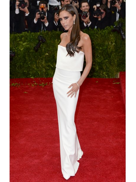 Victorial Beckham in a white dress on the red carp