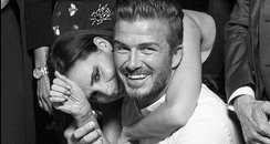 David and Victoria Beckham hug