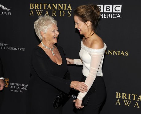 Judi Dench and Emma Watson laughing