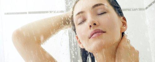 Woman rinsing hair