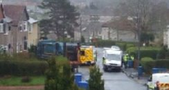 The bin lorry in the front garden