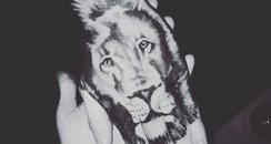 Liam Payne lion hand tattoo