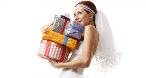 Bride in wedding dress with presents