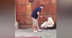 Tourist gives his shoes to homeless man