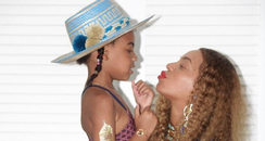 Beyonce balances Blue Ivy on her baby bump