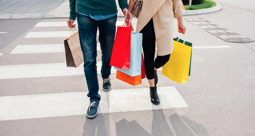 Couple Shopping Together With Shopping Bags